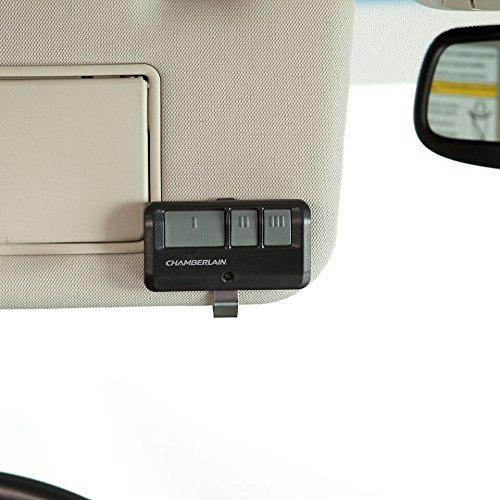 A Chamberlain Garage door opener clipped to a car sun visor